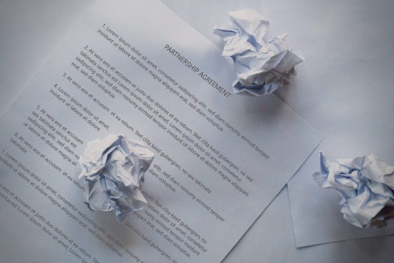 image of what happens if I breach a contract paper crumpled